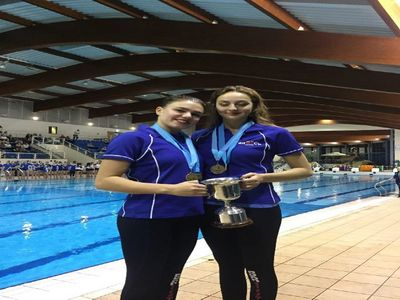 Greta and Daniella with centenary trophy and overall medals.png